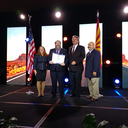 Instructors Brady Nielsen and Jim Brady accepting an award from the National Security Agency and Department of Homeland Security after SFCC was named a Center for Academic Excellence