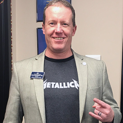 Spokane Community College that President Kevin Brockbank wearing a metallica t-shirt