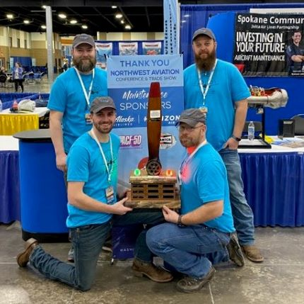 four aviation students with first place trophy