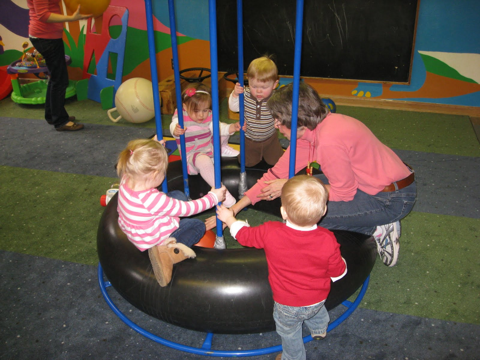 Children playing on a bouncy tire